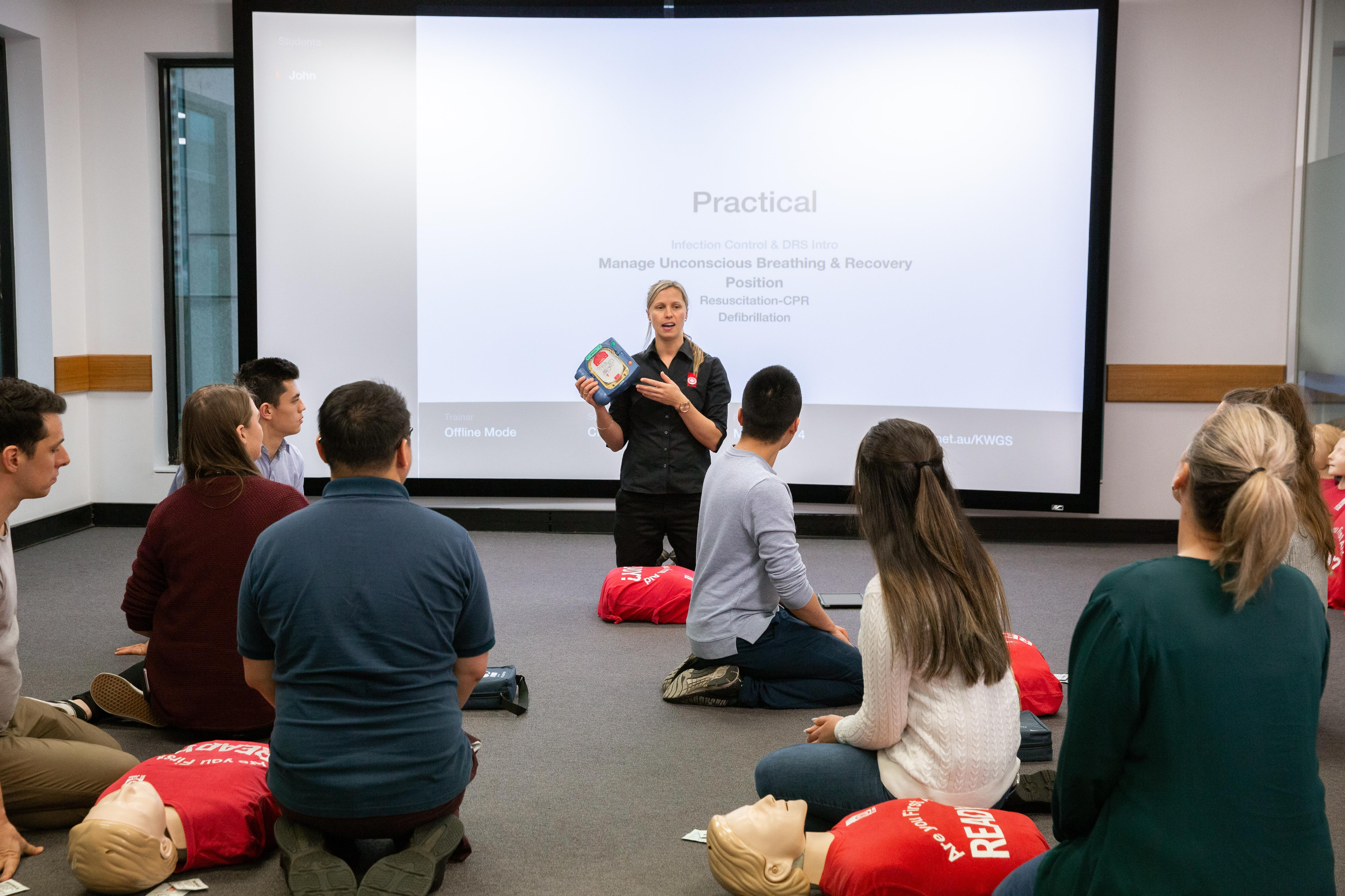 St John first aid training - trainer and students