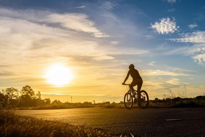 Cyclist riding off into the sunset