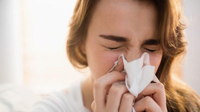 Aussie Flu woman sneezing