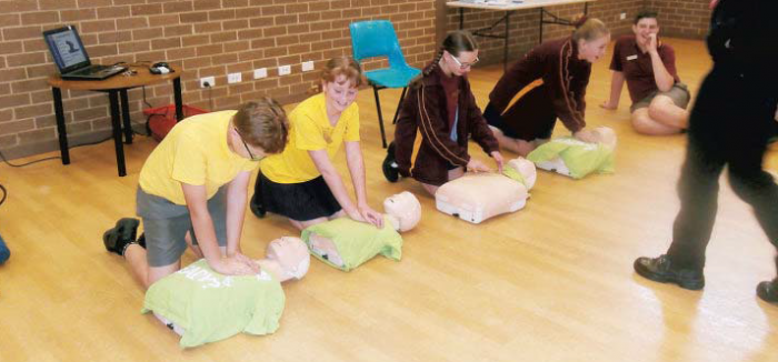 St Kieran promoting health and wellbeing school children learning CPR