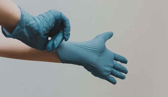 Putting on gloves PPE
