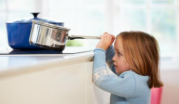 Child Pulling Down Saucepan