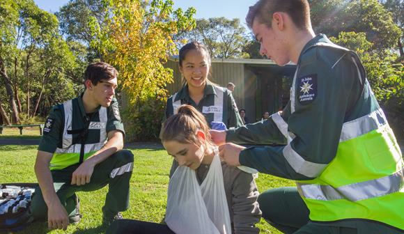 st john youth volunteers practicing first aid at camp