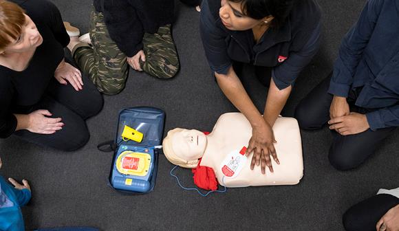 St John first aid training - trainer, students and manikin