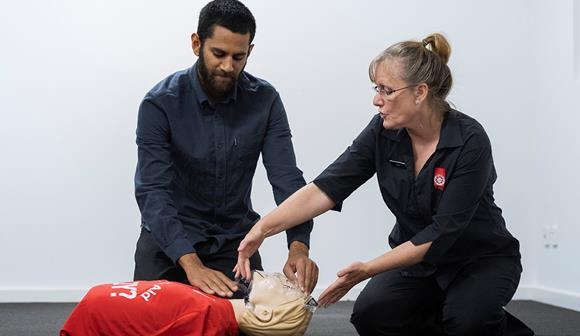 St John first aid training - trainer, student and manikin