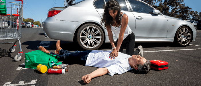 CPR first aid in the carpark