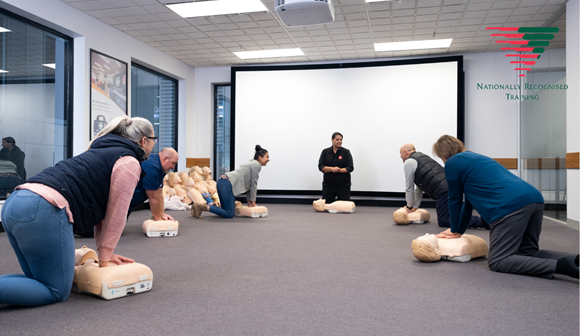Group of first aid training participants socially distanced