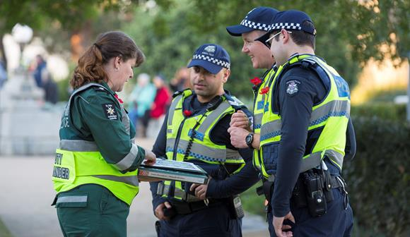 St John event volunteer working together with Victoria Police